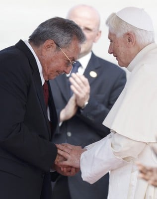 CUBA'S PRESIDENT RAUL CASTRO GREETS POPE UPON HIS ARRIVAL TO SANTIAGO DE CUBA