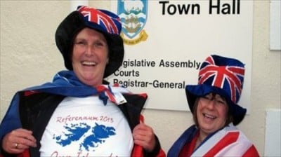 A-woman-shows-her-T-shirt-in-Stanley-Falkland-Islands-on-March-10-2013.-Image-via-AFP.