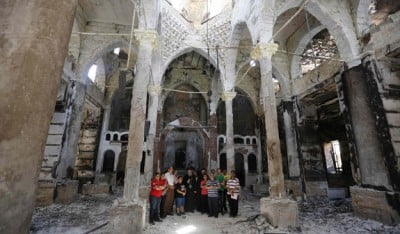 Coptic Orthodox bishop prays with local residents at damaged church in Minya, Egypt