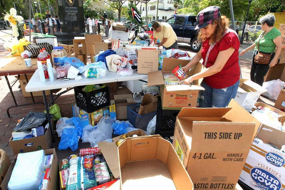 "Alma Aguilera helps organize donations to be transported to Mexico to help Cubans stranded in that nation following the end to an immigration policy known as ""wet foot, dry foot."""