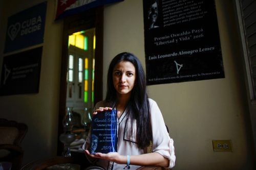 Rosa Maria Paya, daughter of late Cuban dissident Oswaldo Paya, poses for a photo as she holds the Oswaldo Paya Award for Liberty and Life at her home in Havana, Cuba.