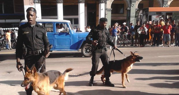Black berets with dogs patrolling the center of Havana.