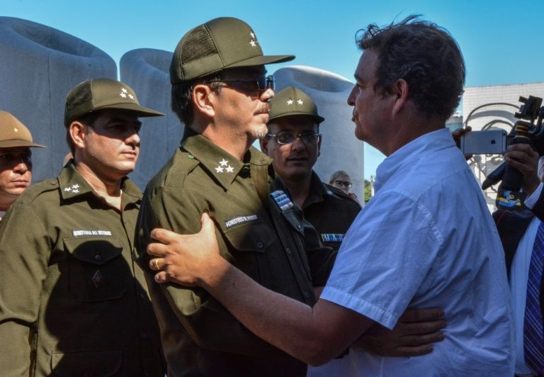 Alejandro Castro Espin (C) has kept a low profile for years, but many observers now tip him to be a major player in the power transition due when his father, Raul Castro, is due to step down