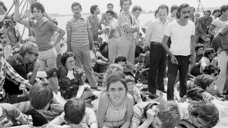 1980. Cuban refugees wait to disembark in Key West, Florida.