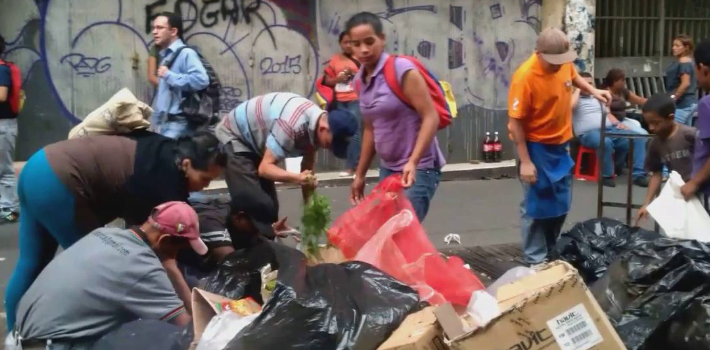 venezuelans search for food in trash